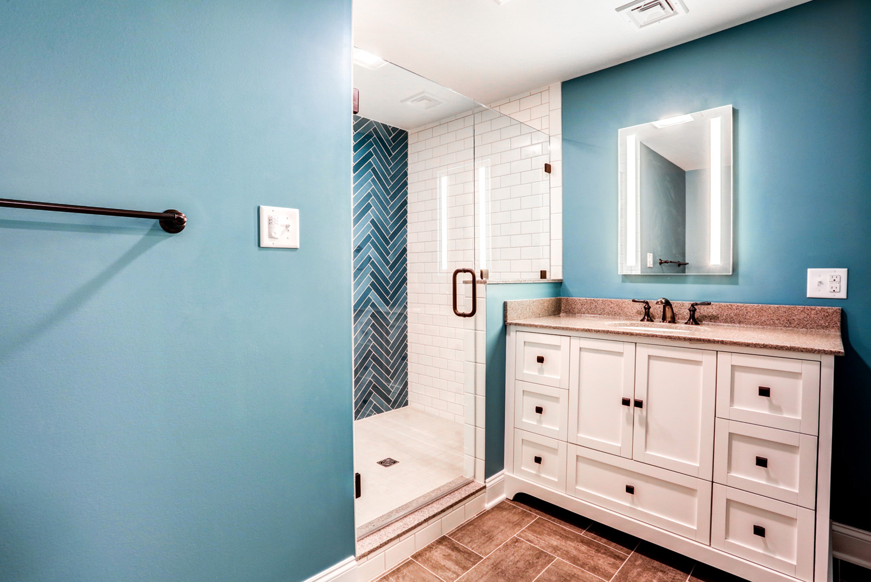 Basement bathroom with blue herringbone shower tile in Lancaster PA