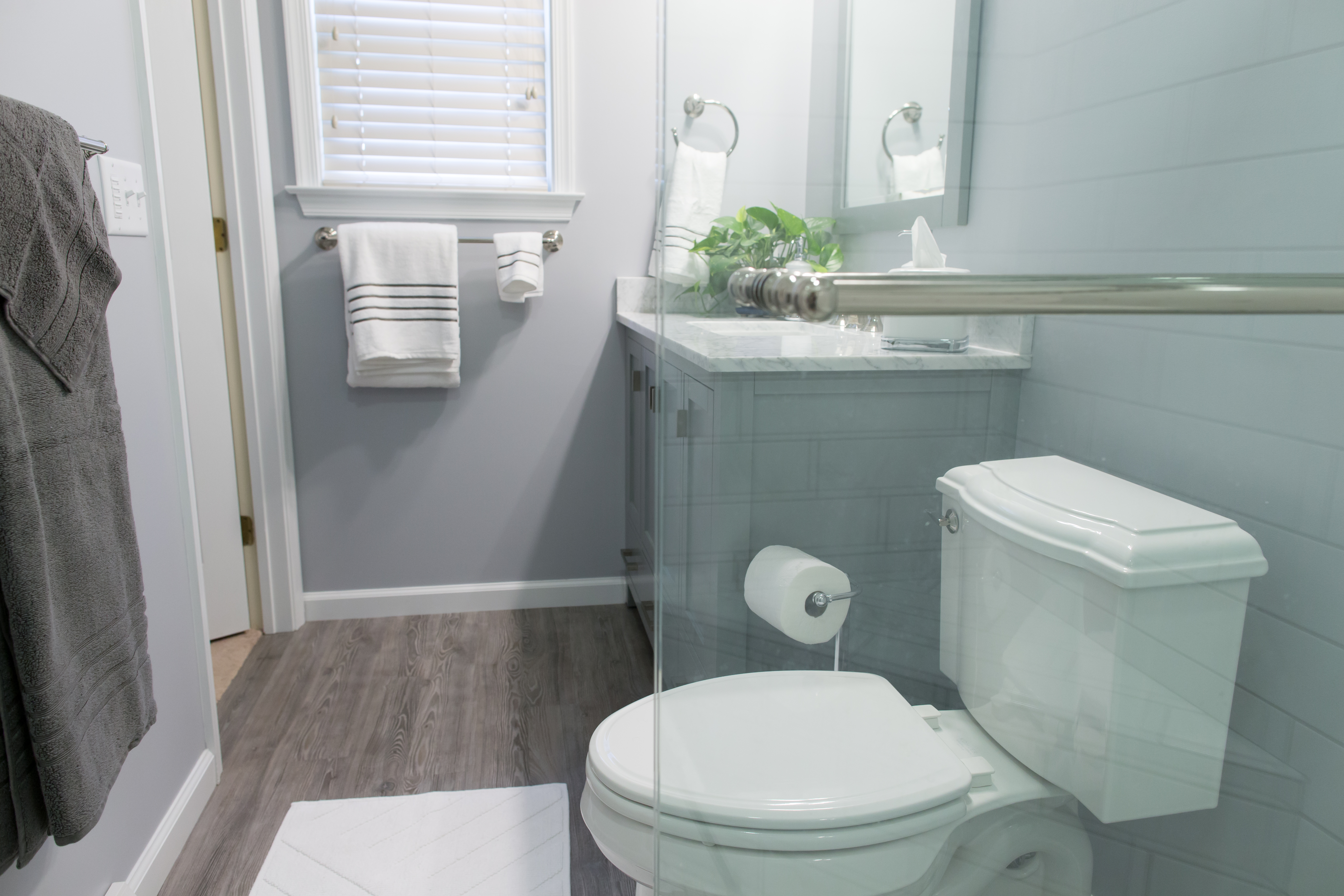 Compact master bathroom remodel with gray finishes