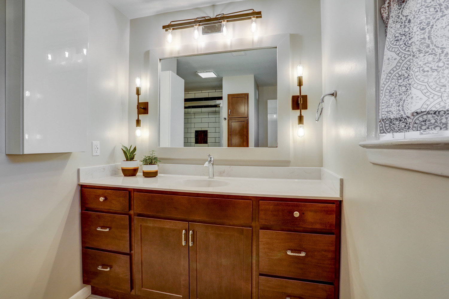 Vanity and wall sconces in Manheim Township master bathroom remodel