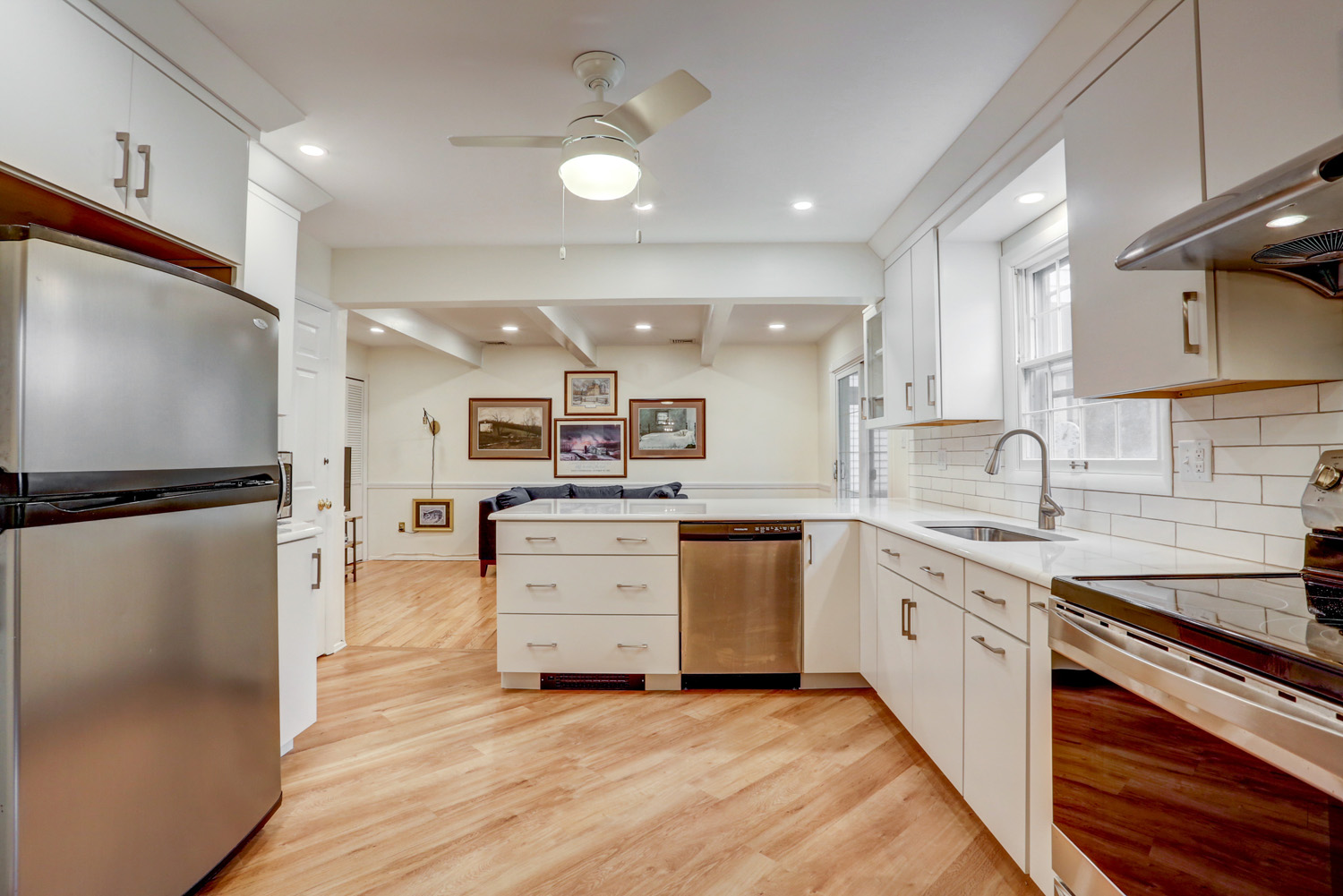 Kitchen remodel with white cabinets and wood accents in Lancaster PA