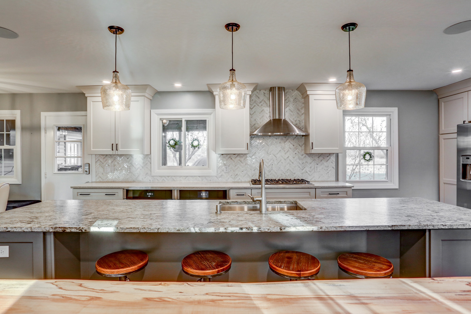 Island bar top with industrial stool in Lancaster kitchen remodel