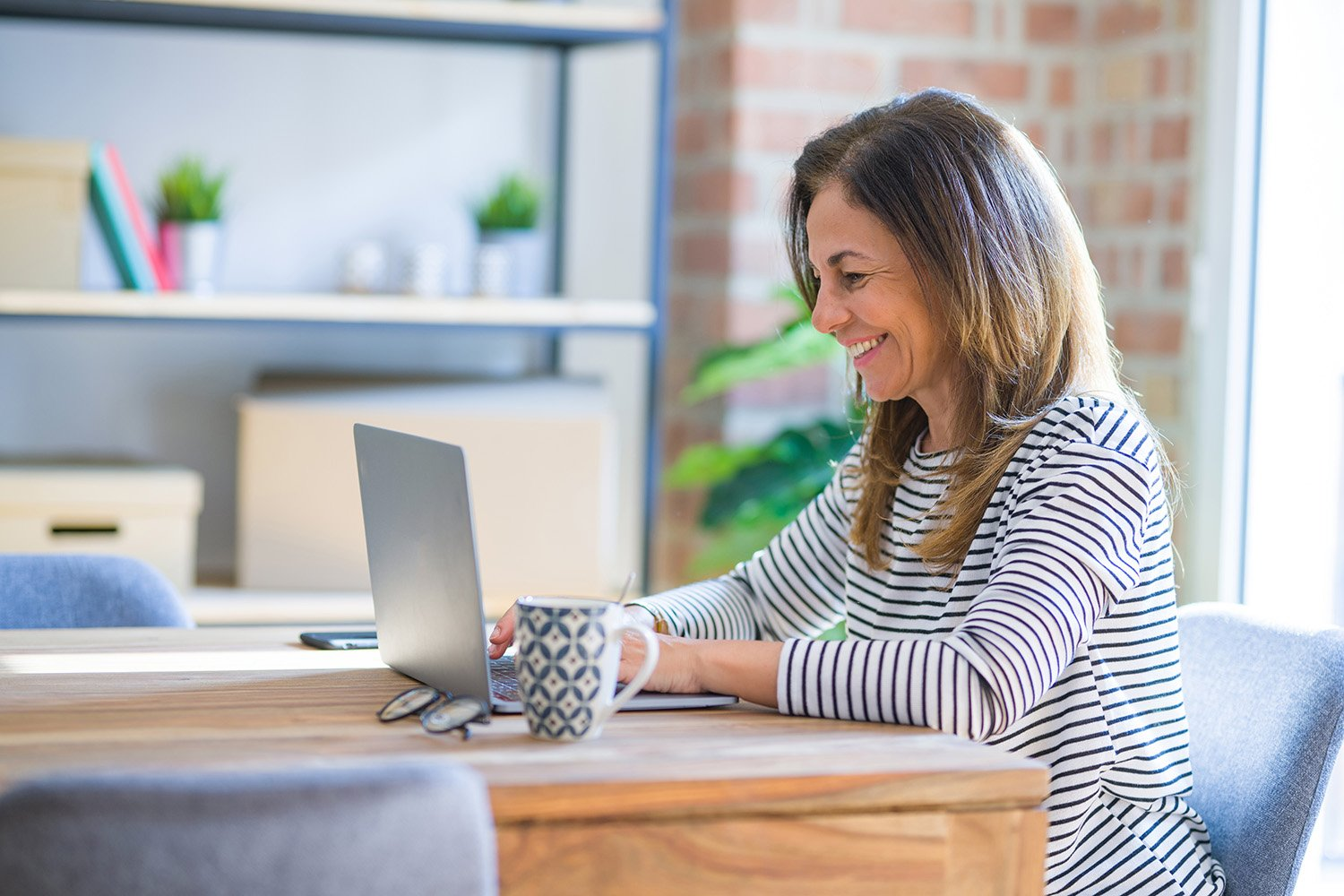Woman participating in virtual consultation about remodel