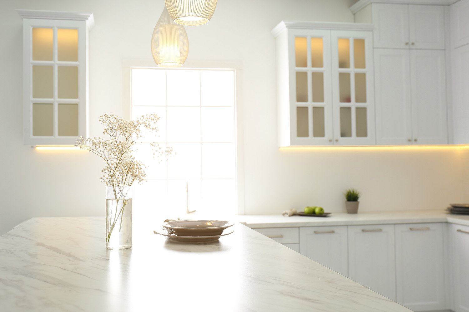 sun coming through window in newly remodeled kitchen